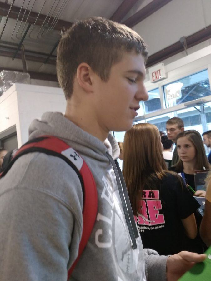 Cole Smay checking out some college information.