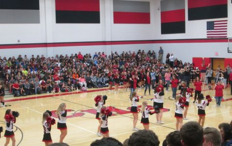 Cheerleaders, band , and majorettes perform