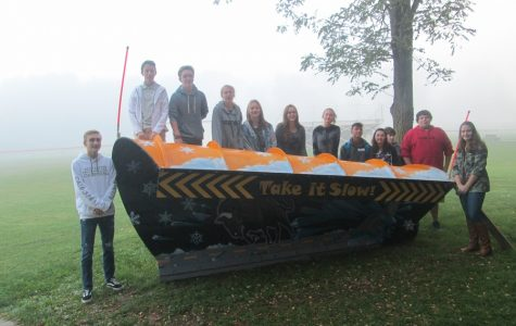From left, are students who painted the plow at Clearfield: Zack Hess, Hayden Miles, Remy Mathews, Madison Oswalt, Rileigh Lonjin, Neveah Moore, Mady Liptak, Kyler Rosinsky, Onyx Libreatori, Faith Irwin, Kenny Gill, and Makeeli Redden. Not pictured: Mindy Flemming