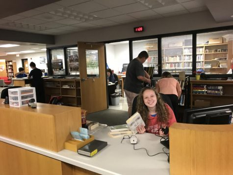 Students are helping out our school's library staff