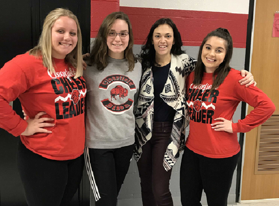 From left to right, Brianna Shaw, Makeeli Redden, Mrs. Zimmerman, and Ally Hertlein standing in the hall smiling.