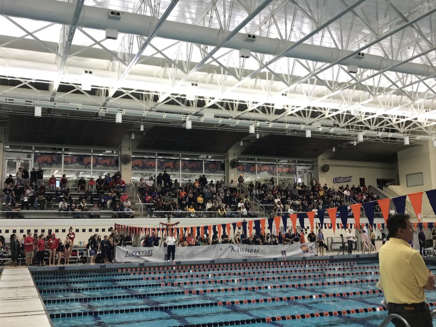 Family members, friends, and fans watch the meet from the stands.