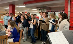 The Caroling Choir performs at the faculty luncheon.