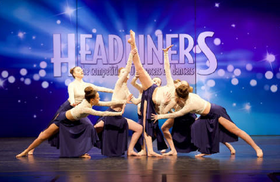 The junior competition team performs Heaven I Know at Headliners dance competition.
