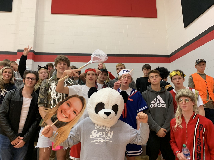 The+whole+student+section+poses+with+their+Halloween+costumes.+