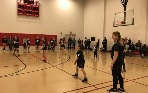 Volleyball players coaching YMCA youth