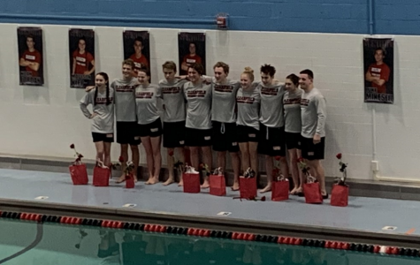 The swim team seniors pose for one last picture. From left to right, the seniors are: Elise DuFour, Noah Jordan, Madison Kipp, Justin Maines, Parker Marshall, Luke Mikesell, Raegan Mikesell, Doyle Mussleman, Emily Shipley, and Brett Zattoni.