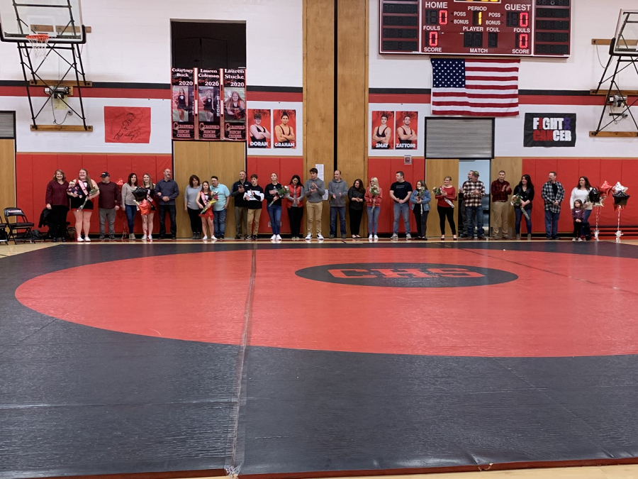 Everyone+lined+up+along+the+back+of+the+mat+for+one+final+photo.+The+wrestlers+are+not+in+this%2C+as+they+had+to+go+warm+up.+
