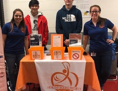 Student council members Crae Ruiz and Cade Walker are helping the members of the Healthy Body  Project collect their data on the carrot fries.