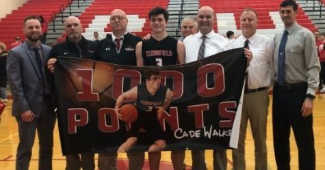 Cade Walker, center, and coaches celebrate Cade
