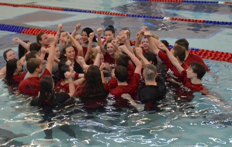 The Clearfield Swim Team celebrates after both teams win District IX title.