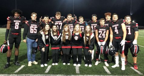 Senior cheerleaders and players after the game.
