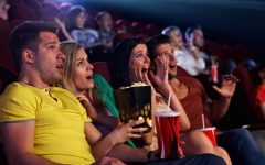 Audience watching a horror movie in a movie theater. (Source: 123RF.com)