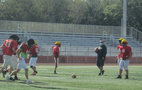 The football team practices for the next game.