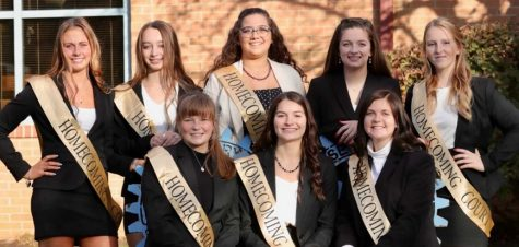 Homecoming court sitting in front of the Shaw Public Library. Shown, from left, are, front row: Charlise McSkimming, Emily Hanes, and Kendhyl Luzier; and back row: Karli Bietz, Sydney Salvatore-Trinidad, Homecoming Queen Rylee Biancuzzo, Megan Durandetta, and Morgan Cheek.