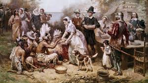The Pilgrims greet the Native Americans.  Source: Bettmann Archive/Getty Images from history.com/topics/thanksgiving/history-of-thanksgiving