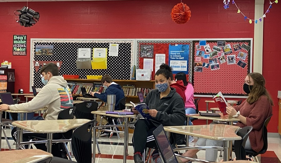Several seniors working on their senior paper in Mrs. Warlows class room.