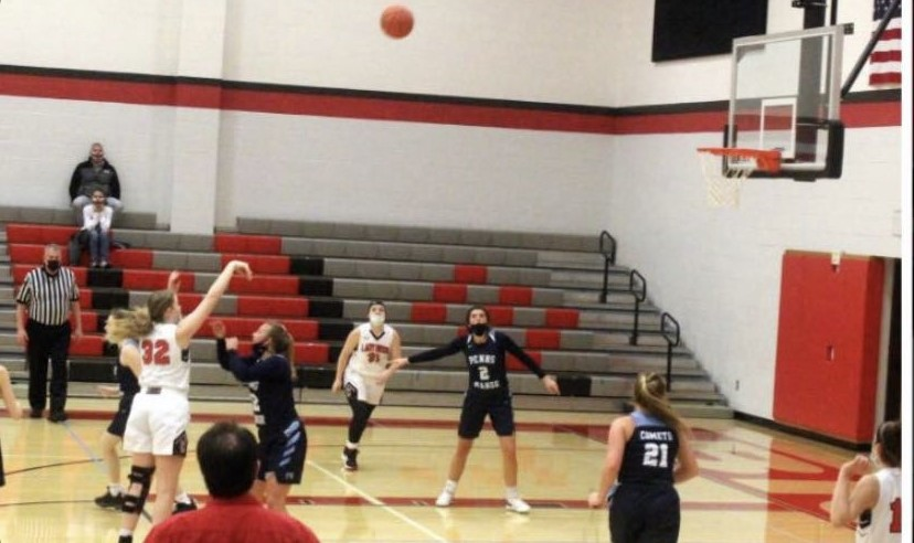 Paige Rhine takes aim during a recent basketball game.