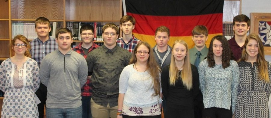 """Thirteen Clearfield High School students were recently inducted into Delta Epsilon Phi, the National Honor Society for German Students.  Membership requirements include an """"A"""" in German after at least three semesters, a """"B"""" average over-all, and a clean record of conduct throughout high school.  Pictured below are (left to right)  Kate Barnes, Austin McDanel, Ian Heitsenrether, Nick Blake, Alex Owens, Matt Cowder,     Zoe Poole, Charles Gardner, Alexis   Graham, Logan Sloppy, Emily Shipley, Cade Walker, and Avry Grumblatt.   Mrs. Barbara Simpson is the German teacher who organized the ceremony."""