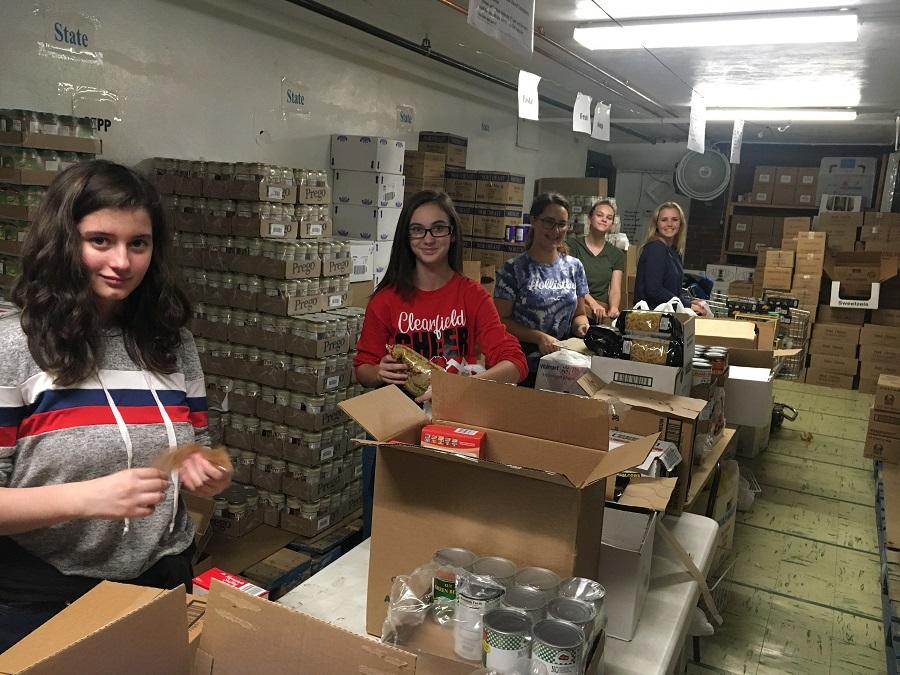 Jamie Irwin, Reagen Rupp, Kelcie Van Tassel, Brianna Miller and Nevaeh Moore help bag foods at the food bank.