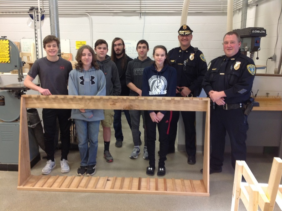 From left to right: Justin Hand. Martin Daub, Matt Brown, Matt Stiner, Tyler Olsen, and Briana Miller.  Also pictured: Officer Marshall and Chief Doug Clark.