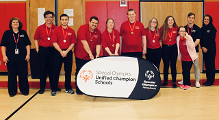 The Bocce team poses for a photograph with the Special Olympics banner coming away from their championship win.