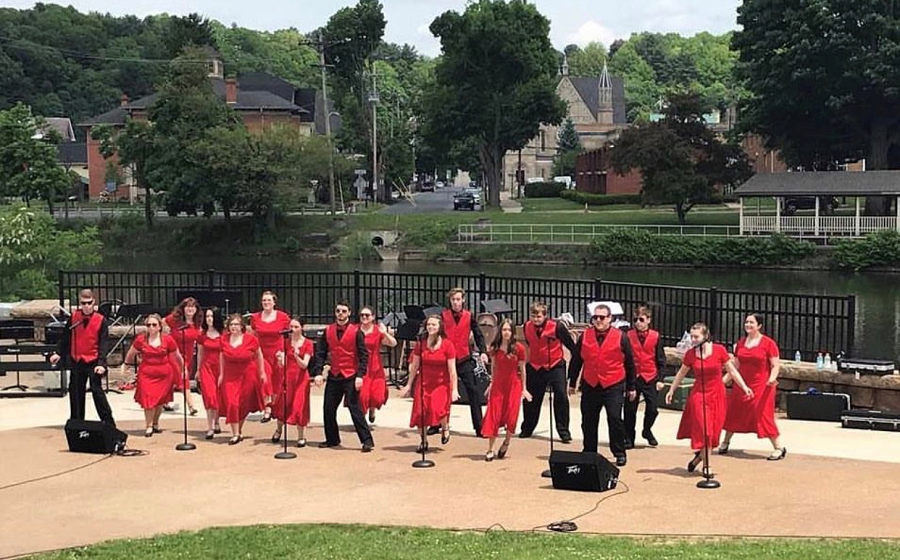 The CHS show choir from last year performs at the Riverwalk.