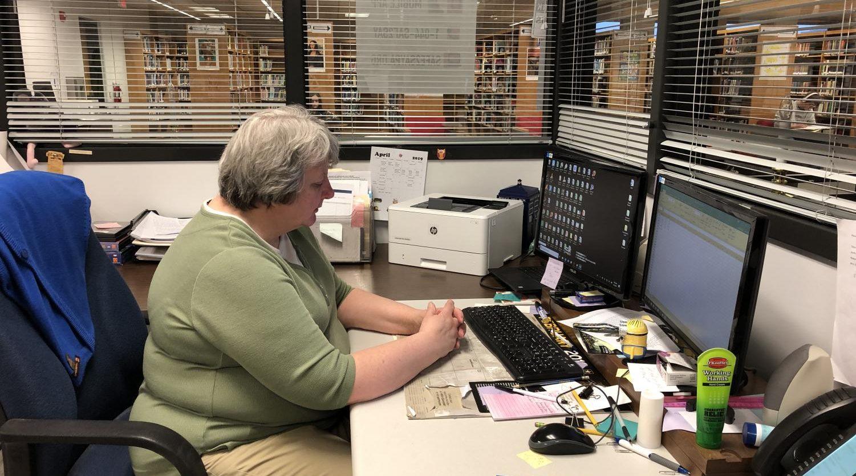 Mrs. Brady working hard at her desk