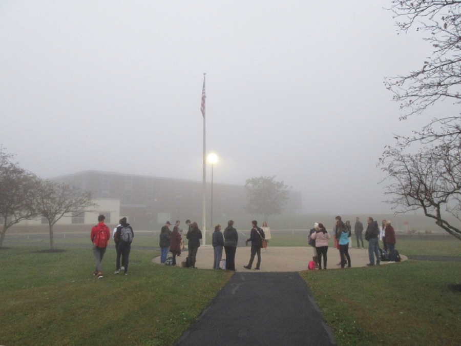 Students gather around the pole Wednesday morning to pray, worship, and enjoy time of fellowship