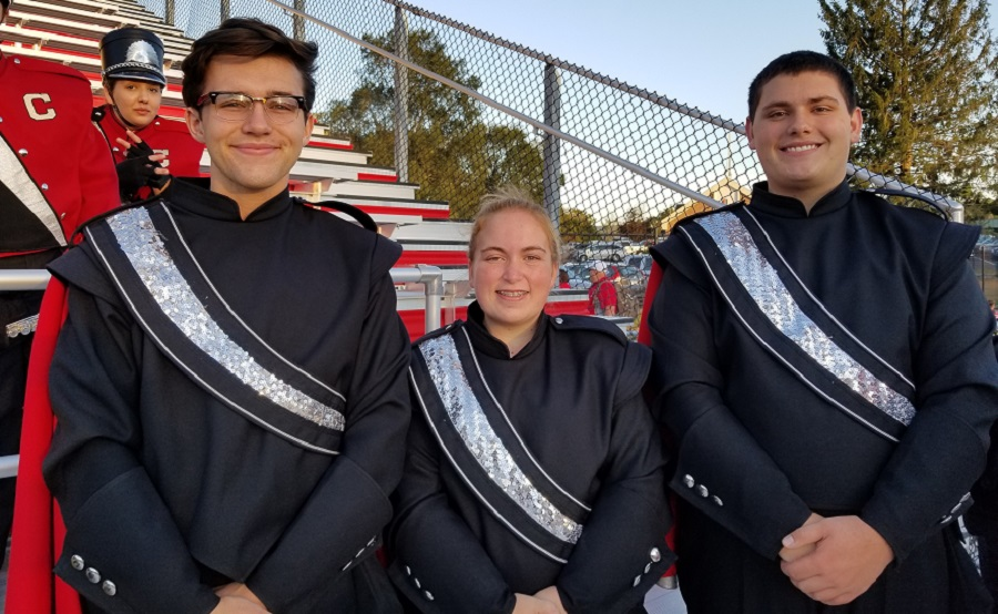 Drum Majors Cruz Wright, Shelby Flanagan, and Philip Rowles