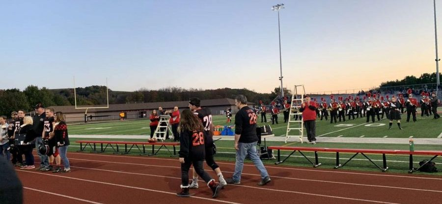 Football players recognized for Senior Night.