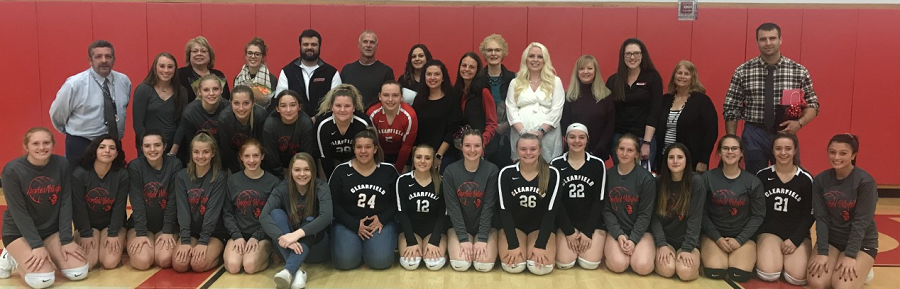 Volleyball players with the teachers of their choice.