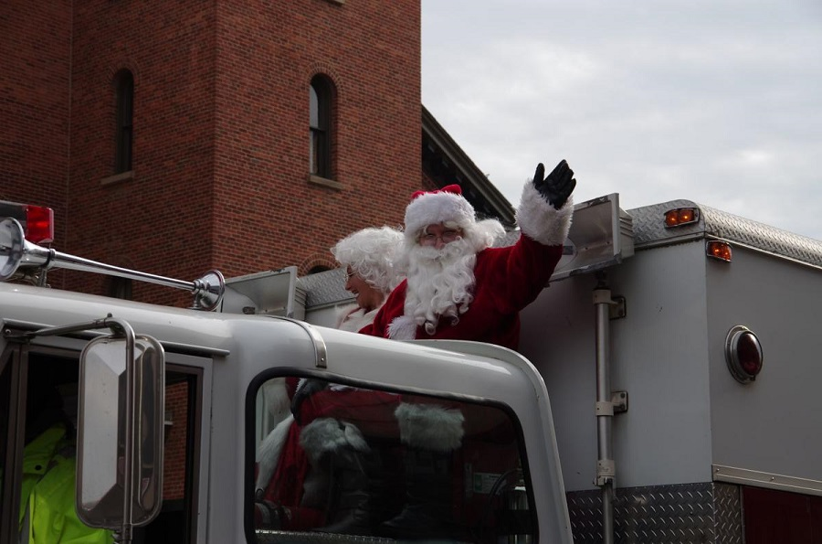 Santa and Mrs. Clause ride on a fire truck at the 2018 Holiday parade.