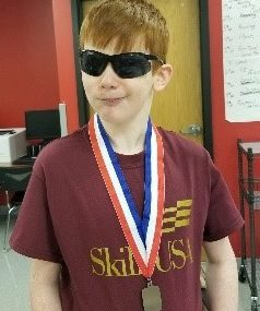 Cameron with his second place medal at the Skills USA competition.
