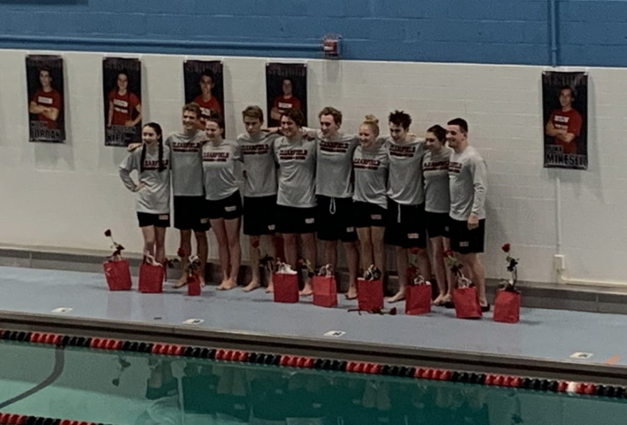The+swim+team+seniors+pose+for+one+last+picture.+From+left+to+right%2C+the+seniors+are%3A+Elise+DuFour%2C+Noah+Jordan%2C+Madison+Kipp%2C+Justin+Maines%2C+Parker+Marshall%2C+Luke+Mikesell%2C+Raegan+Mikesell%2C+Doyle+Mussleman%2C+Emily+Shipley%2C+and+Brett+Zattoni.+