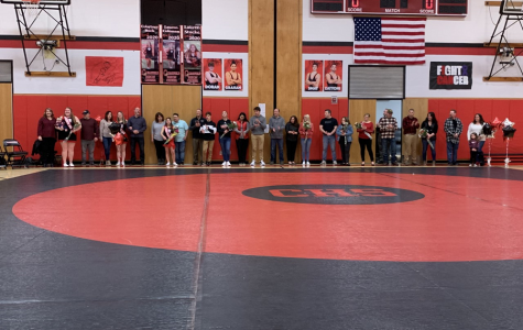 Everyone lined up along the back of the mat for one final photo. The wrestlers are not in this, as they had to go warm up.