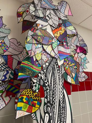 The art department has created a zentangle tree displayed in the art hallway.