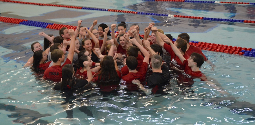 The+Clearfield+Swim+Team+celebrates+after+both+teams+win+District+IX+title.