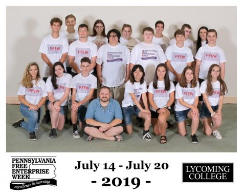Rachel Owens, kneeling, lower left, poses with her group at PFEW.