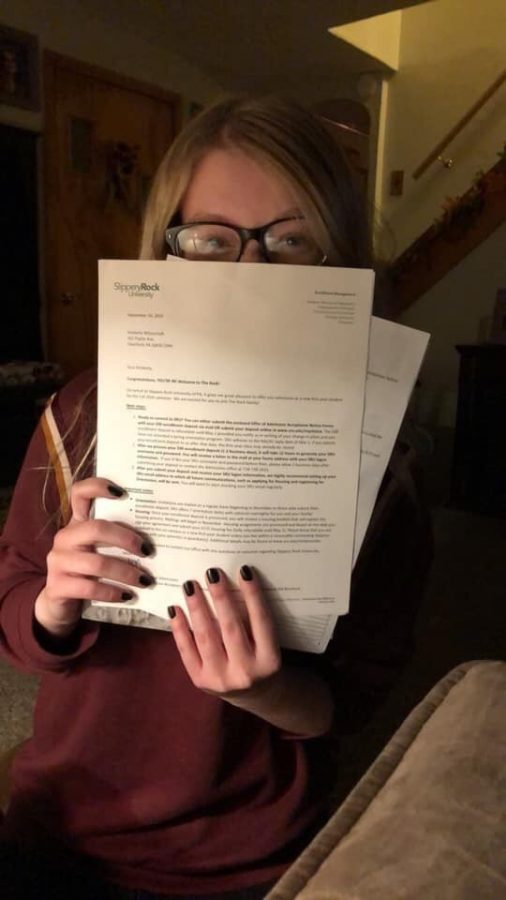 Kimberly+Wilsoncroft+holds+her+acceptance%2F+scholarship+letter.