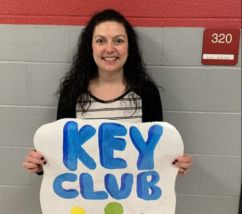 Mrs. Borden, one of the Key Club advisors with her Key Club sign.