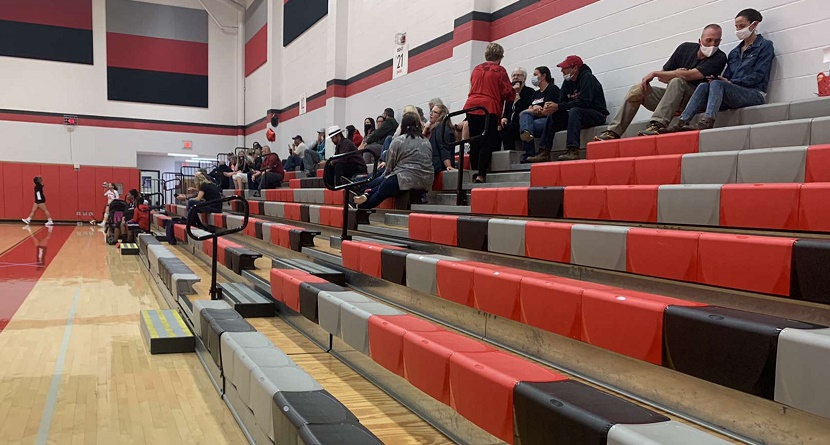 Spectators at the girls' volleyball game.