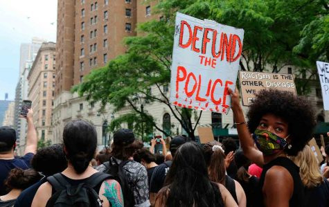 """Protester in New York cries out """"Defund the Police"""" at a George Floyd protest. Source: abcnews.go.com."""
