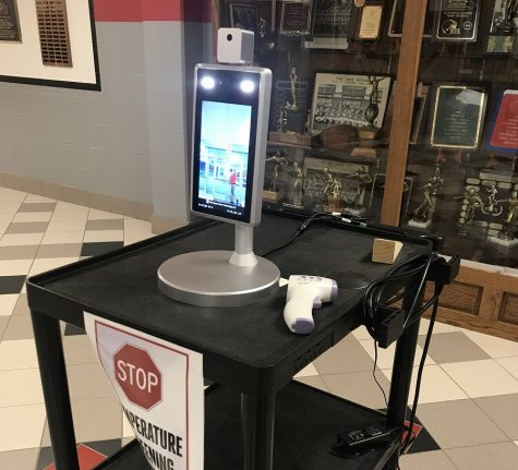 Temperature scanner in lobby of high school.