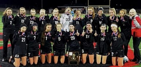 The girls Varsity soccer winning the District 9 title for year 2020