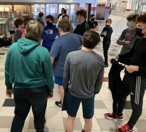 Students gather indoors at a recent Track and Field practice session.