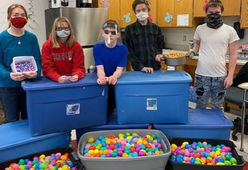 Mrs. Mease's students help fill the eggs for the hunt.